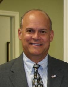 Dr. Lawrence Mussoline