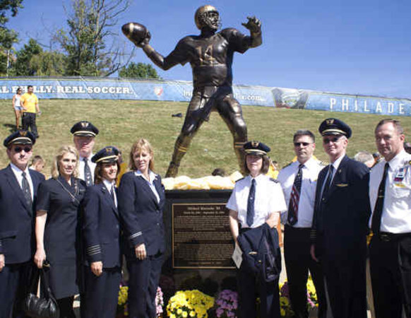 Friends and colleagues from two airlines were on hand at the 2010 unveiling of Mike's likeness.--photo via Philly.com