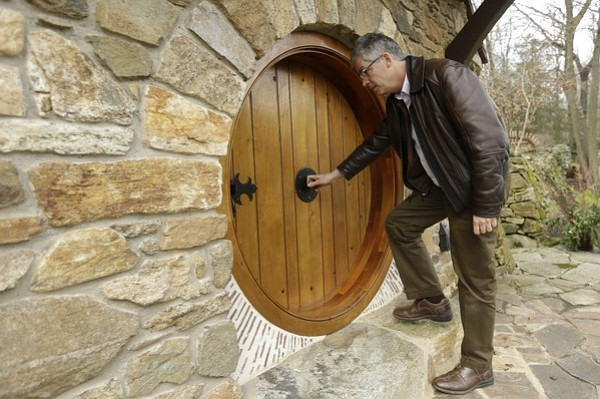 Architect Peter Archer enters the  Hobbit House  during an interview with the Associated Press--photo via AP.