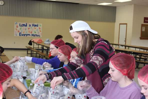 Rustin High School Students Prepare 10,000 Meals to Help Alleviate World Hunger