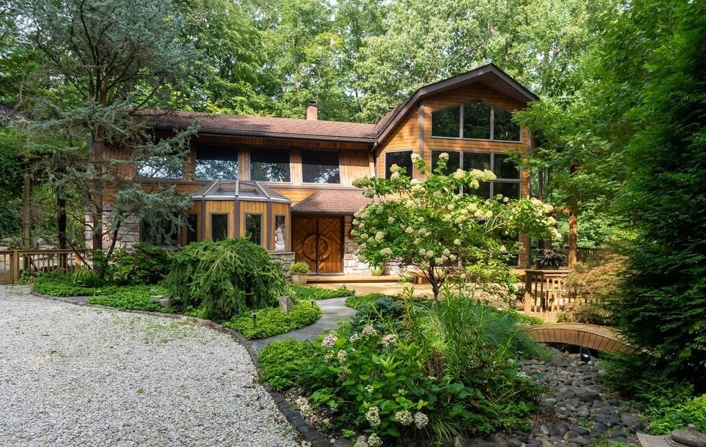 Malvern Bank House of the Week: Soaring Ceilings, Walls of Windows Amidst Nature in Phoenixville