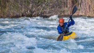 man whitewater kayaking