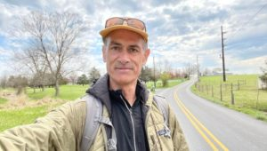 Neil KIng walking through Chester County