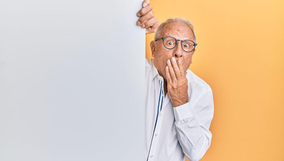Mistaken older man in a white jacket