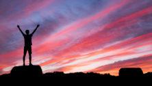 Runner siloetter against a sunset