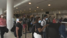A crowd waits in line at the Philadelphia International Airport