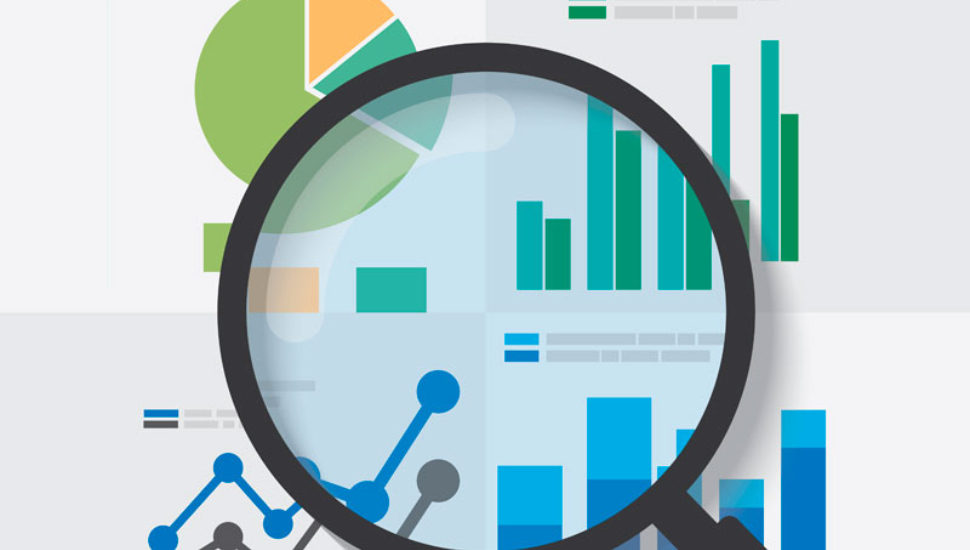 A graphic showing a magnifying glass looking at various business charts for reserach.