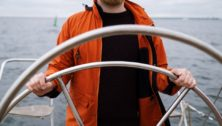 Captain steering a sailboat