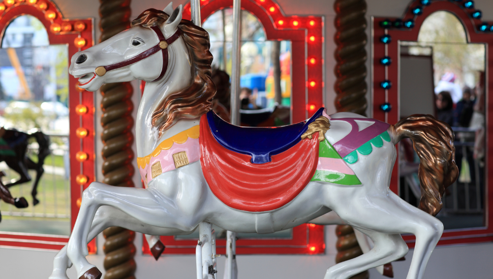 A colorful house on a carousel.
