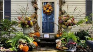 The front door of a home decorated for fall.