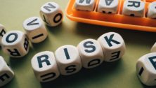 Letter game spelling out the word RISK