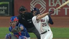 baseball player hitting homer
