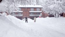 two men shoveling snow